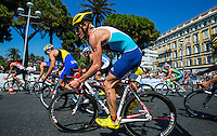 16 SEP 2012 - NICE, FRA - Will Clarke of Lagardere Paris Racing  begins a new lap on the bike during the final stage of the French Grand Prix triathlon series held during the Triathlon de Nice Côte d'Azur (PHOTO (C) 2012 NIGEL FARROW)