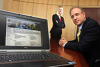 Jason Stone, right, and Emily Harris designed Davis Brown Law Firm's Start-Up Launchpad, a website that offers legal documents for flat fees, and is meant to be a specific resource for startup businesses.