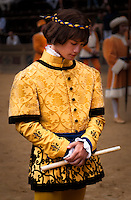 A character of the Palio di Siena parade with a beautiful yellow and black dress