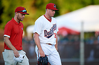 Auburn Doubledays relief pitcher Aaron Barrett (30) walks off the field with athletic trainer Kirby Craft during a game against the Batavia Muckdogs on June 15, 2018 at Falcon Park in Auburn, New York.  Barrett was pulled from the game due to injury;  he has not pitched since 2015 after undergoing Tommy John surgery and fracturing his elbow in 2016.  Auburn defeated Batavia 5-1.  (Mike Janes/Four Seam Images)