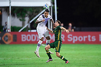 LAKE BUENA VISTA, FL - AUGUST 11: Antonio Carlos #25 of Orlando City SC heads the ball during a game between Orlando City SC and Portland Timbers at ESPN Wide World of Sports on August 11, 2020 in Lake Buena Vista, Florida.