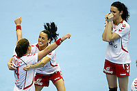 SERBIA, Novi Sad: Poland's national handball team players Karolina Kudlacz (L), Kinga Grzyb (C) and Karolina Szwed (L) celebrate victory after Women's Handball World Championship 2013 eight-final match Poland vs Romania on December 15, 2013 in Novi Sad.   AFP PHOTO / PEDJA MILOSAVLJEVIC