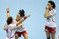 SERBIA, Novi Sad: Poland's national handball team players Karolina Kudlacz (L), Kinga Grzyb (C) and Karolina Szwed (L) celebrate victory after Women's Handball World Championship 2013 eight-final match Poland vs Romania on December 15, 2013 in Novi Sad.   AFP PHOTO / PEDJA MILOSAVLJEVIC