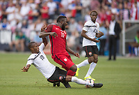 Commerce City, CO - Thursday June 08, 2017: Kevan George, Jozy Altidore during a 2018 FIFA World Cup Qualifying Final Round match between the men's national teams of the United States (USA) and Trinidad and Tobago (TRI) at Dick's Sporting Goods Park.