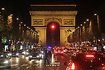 Traffic and the Arc de Triomphe at night, along the Avenue des Champs Elysees, Paris, France.