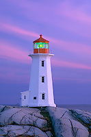 Granite headland<br />   and Peggy's Point Lighthouse at sunset<br /> Peggy's Cove Preservation Area<br /> Nova Scotia,  Maritime Provinces,  Canada