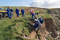 Maritime and Coastguard Agency rescuing female tourist who had fallen down cliff face. This image may only be used to portray the subject in a positive manner..©shoutpictures.com..john@shoutpictures.com