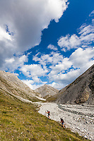 Hiking along a tributary creek that flows into the Marsh Fork of the Canning River in the Arctic National Wildlife Refuge in the Brooks Range mountains, Alaska.