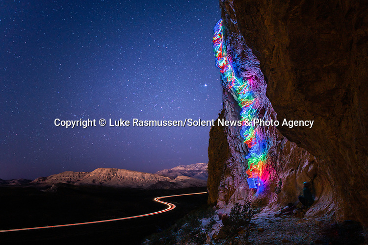 """Pictured:  A 1 minute 32 seconds exposure at Blue Diamond Cave, Las Vegas, NV<br /> <br /> Bright bolts of colourful light snake their way across mountains and cliffs.  The striking images were created by a rock climber who wrapped LED lights around his body before capturing long exposure shots of his route.<br /> <br /> Luke Rasmussen took the photos in the deserts of Nevada, in the United States, and admits that his method of 'freezing time in a moment' is unusual.  The 28 year old photographer said: """"Wearing a sweater full of lights and climbing through the darkness of night is certainly a different experience than most climbers will get.  SEE OUR COPY FOR DETAILS.<br /> <br /> Please byline: Luke Rasmussen/Solent News<br /> <br /> © Luke Rasmussen/Solent News & Photo Agency<br /> UK +44 (0) 2380 458800"""