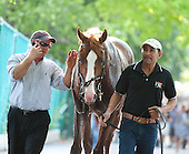 Shackleford heads back to the barn after the Met. With Scott Everett, left, assistant to trainer Dale Romans.