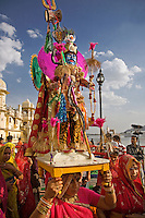Rajasthani women carry effigies of Shiva and his wife Parvati at the GANGUR FESTIVAL also known as the MEWAR FESTIVAL in UDAIPUR - RAJASTHAN, INDIA