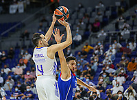 30th September 2021; Madrid, Spain:  Euroleague Basketball, Real Madrid versus Anadolu Efes Istanbul;  Thomas Heurtel of team Real Madrid shoots over the block from Vasilije Misic of team Anadolu Efes and during the Matchday 1 between Real Madrid and Anadolu Efes Istanbul