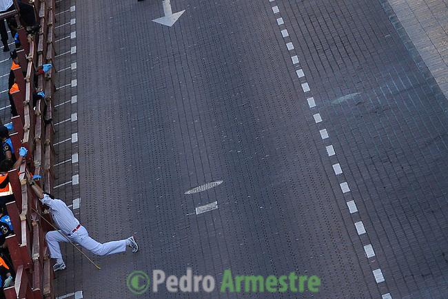 A pastor performs stretching before the bull run of Condes de la maze's bulls in San Sebastian de los Reyes Festival, near Madrid, on august 28, 2014. AFP PHOTO/ PEDRO ARMESTRE
