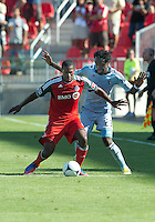 18 August 2012: Sporting KC forward Kei Kamara #23 and Toronto FC defender Doneil Henry #4 in action during an MLS game between Sporting Kansas City and Toronto FC at BMO Field in Toronto, Ontario Canada..Sporting Kansas City won 1-0.