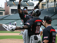 August 8, 2009:  Chevez Clarke, Deshun Dixon, and Alex Ramsay of Baseball Factory celebrate after winning the Under Armour All-America game at Wrigley Field in Chicago, IL.  Photo By Mike Janes/Four Seam Images
