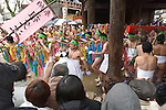 February  20th, 2016, Inazawa, Japan - Festival participants are carrying ceremonial bamboo poles wrapped in long pieces of cloth made of hundreds of small cloth through the main gate of Konomiya Shrine on Saturday, February 20, 2016.<br /> The festival organised by Konomiya Shrine, takes place annually on the 13th of the lunar calendar. It is one of the oldest festivals in Japan. Since the old days, the participants are men only, mostly of the ages 24, 42 and 61, which are considered unlucky in Japan. By taking part in the festival they are hoping to avoid the bad luck throughout the coming year.