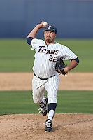 Koby Gauna #32 of the Cal State Fullerton Titans pitches against the Washington State Cougars at Goodwin Field on  February 15, 2014 in Fullerton, California. Washington State defeated Fullerton, 9-7. (Larry Goren/Four Seam Images)