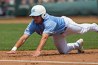 North Carolina outfielder Chaz Frank (2) dives back to first base during Game 3 of the 2013 Men's College World Series against the North Carolina State Wolfpack at TD Ameritrade Park on June 16, 2013 in Omaha, Nebraska. The Wolfpack defeated the Tar Heels 8-1. (Andrew Woolley/Four Seam Images)