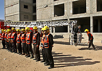 """Hamas-led civil emergency workers carry out a drill on extinguishing a fire in Gaza December 27, 2007.<br /> """"photo by Fady Adwan"""""""