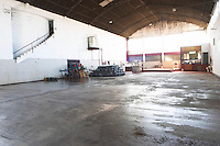 Lots of empty space in the big winery building. Some demijohns in one corner. Bodega Plaza Vidiella Winery, Las Brujas, Canelones, Uruguay, South America