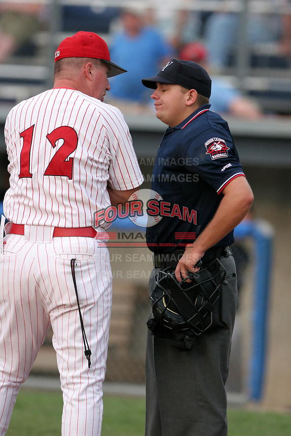 Umpire Barry Lee listens to Batavia Muckdogs manager Steve Roadcap argue a call during a NY-Penn League game at Dwyer Stadium on July 30, 2006 in Batavia, New York.  (Mike Janes/Four Seam Images)
