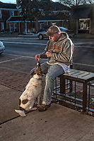 Man feeds his dog donuts from Schneiders Bakery in Uptown Westerville.