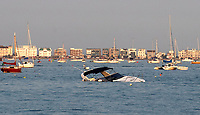 BNPS.co.uk (01202 558833)<br /> Pic: ZacharyCulpin/BNPS<br /> <br /> Pictured: The boat in Poole Harbour last night with Sandbanks pictured in the background<br /> <br /> This is the dramatic moment a £130,000 yacht sank at sea after being swamped by water.<br /> <br /> Its owners, a man and woman, were taking the 42ft Fairline motor cruiser called Harley to a yacht club mooring when it got into difficulty in Poole Harbour, Dorset.<br /> <br /> The couple had to abandon ship as the luxury vessel partially-sunk in the water.