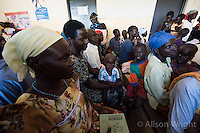 N. Uganda, Kitgum District. Peter C. Alderman Foundation project. Namokana Outreach Center where patients come for initial psychiatric assessment. Michael Okech, psychiatric hospital staff. The waiting area is small and overcrowded, with one small room for evaluation.