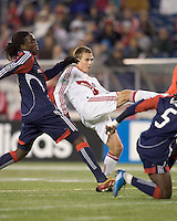 Chicago Fire forward Chris Rolfe (17) shoots from a crowd in front of the net as New England Revolution midfielder Shalrie Joseph (21) defends. The New England Revolution tied the Chicago Fire, 0-0, at Gillette Stadium on October 17, 2009.