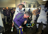 Pictured: Coach Gary Richards gets drenched in champagne by Oliver McBurnie and other players Monday 15 May 2017<br />Re: Premier League Cup Final, Swansea City FC U23 v Reading U23 at the Liberty Stadium, Wales, UK