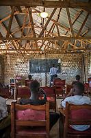 Uganda, Mmanze. Solar lights used in classrroms at Christ City School.