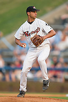 Winston-Salem starting pitcher Carlos Torres winds up to deliver the ball to the plate versus Kinston at Ernie Shore Field in Winston-Salem, NC, Tuesday, July 4, 2006.  The Warthogs defeated the Indians 3-2.