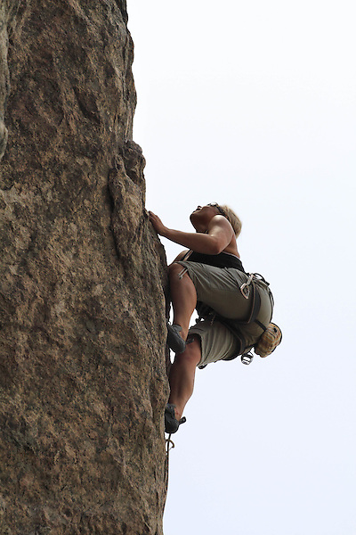 Female rock climber on a route in Clear Creek Canyon, west of Denver, Colorado. .  John leads private photo tours in Boulder and throughout Colorado. Year-round.