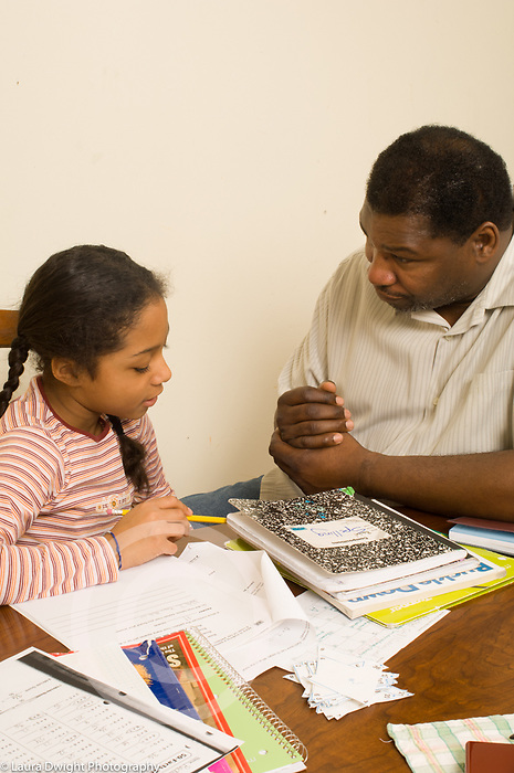 10 year old girl with father, argument discussion about homework, father listening to daughter