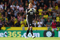 28th August 2021; Carrow Road, Norwich, Norfolk, England; Premier League football, Norwich versus Leicester; Kasper Schmeichel of Leicester City gives the linesman a thumbs up for ruling Norwich City's equaliser offside