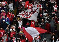 BOGOTÁ-COLOMBIA, 20-10-2019: Hinchas de Independiente Santa Fe animan a su equipo durante partido de la fecha 18 entre Independiente Santa Fe y Unión Magdalena, por la Liga Águila II 2019, jugado en el estadio Nemesio Camacho El Campín de la ciudad de Bogotá. / Fans of Independiente Santa Fe cheer for their team during a match of the 18th date between Independiente Santa Fe and Union Magdalena, for the Aguila Leguaje II 2019 played at the Nemesio Camacho El Campin Stadium in Bogota city, Photo: VizzorImage / Luis Ramírez / Staff.