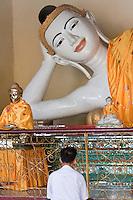 Myanmar, Burma.  Shwedagon Pagoda, Yangon, Rangoon.  Reclining Buddha.