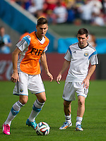 Lionel Messi and Federico Fernandez of Argentina