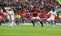 Pictured: Robin van Persie of Manchester United against Dwight Tiendalli (L) and Jonathan de Guzman both of Swansea. Sunday 12 May 2013<br /> Re: Barclay's Premier League, Manchester City FC v Swansea City FC at the Old Trafford Stadium, Manchester.