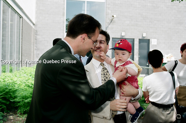 Montreal (Qc) CANADA - May 17 1998<br /> -File Photo -<br /> <br />  municipal candidate Martin Lemay (L) hold hand with a baby.<br /> <br /> Martin Lemay (born March 19, 1964 in Amos, Quebec) is a politician in Quebec, Canada. He is the Parti Québécois (PQ) Member of the National Assembly (MNA) for Sainte-Marie—Saint-Jacques in the National Assembly of Quebec