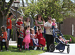 Residents, including this group from the Building Blocks Day Care, line Main Street to watch the funeral procession for former Nevada Assembly Speaker Joe Dini on Tuesday, April 15, 2014, in Yerington, Nev. (Las Vegas Review-Journal/Cathleen Allison)