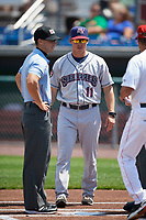 Mahoning Valley Scrappers manager Luke Carlin (11) during the lineup exchange before the second game of a doubleheader against the Auburn Doubledays on July 2, 2017 at Falcon Park in Auburn, New York.  First base umpire Ben Rosen is to the left.  Mahoning Valley defeated Auburn 3-2.  (Mike Janes/Four Seam Images)