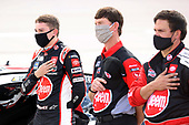 DARLINGTON, SOUTH CAROLINA - MAY 17: Christopher Bell, driver of the #95 Rheem Toyota, and crew members stand on the grid for the national anthem prior to the NASCAR Cup Series The Real Heroes 400 at Darlington Raceway on May 17, 2020 in Darlington, South Carolina. NASCAR resumes the season after the nationwide lockdown due to the ongoing coronavirus (COVID-19).  (Photo by Chris Graythen/Getty Images)