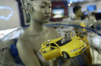 A model holds a Geely Meirenbao model at the Auto China 2004 exhibition in Beijing, China. Geely's profit rose 88 percent in 2006 as it sold more mid-range car.