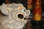 Bao-jhong Yi-min Temple, Kaohsiung -- Stone lion guarding the temple entrance.