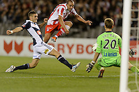 MELBOURNE, AUSTRALIA - MAY 19: Lawrence Thomas of the Victory blocks a shot at goal by Rafik Djebbour of Olympiakos during the match between Melbourne Victory and Olympiakos FC at Etihad Stadium on 19 May 2012 in Melbourne, Australia. (Photo Sydney Low / AsteriskImages.com)