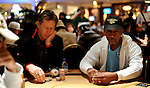 Friend of PokerStars.net Orel Hershisher, left, and Montel Williams seated next to each other durng play on Day 2 of the NAPT Venetian Main Event.