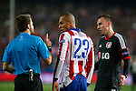 Atletico de Madrid´s Joao Miranda (L) argues with the referee during the UEFA Champions League round of 16 second leg match between Atletico de Madrid and Bayer 04 Leverkusen at Vicente Calderon stadium in Madrid, Spain. March 17, 2015. (ALTERPHOTOS/Victor Blanco)