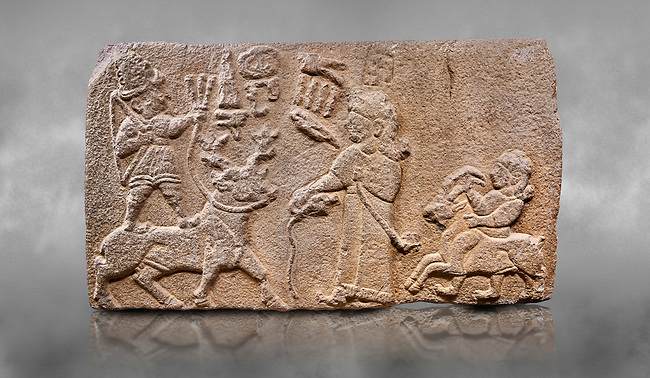 """Aslantepe Hittite relief sculpted orthostat stone panel. Limestone, Aslantepe, Malatya, 1200-700 B.C. Anatolian Civilisations Museum, Ankara, Turkey.<br /> <br /> Scene of king's offering drink and sacrifice to the god. The god is on the deer, with the bow attached to his shoulder and with a triple bundle of lightning in his hand. The king looks at the god, and makes the libation to the god while carrying a scepter with a curled end - lituus. Behind the king is a servant holding a goat for sacrifice to the god. Hieroglyphs read; """"God Parata, Strong King... """". <br /> <br /> Against a grey art background."""