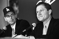 Los Angeles Dodgers pitcher Kevin Brown and player agent Scott Boras at a press conference announcing Brown's signing with the Los Angeles Dodgers at Dodger Stadium during the 1998 season in Los Angeles, California. (Larry Goren/Four Seam Images)